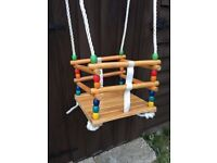 Wooden toddler swing