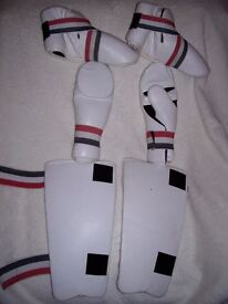 Martial Arts Foot, Shin and Hand Guards will fit someone five foot, two inches approx