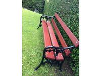 Stunning cast iron garden bench with solid mahogany straps approx 6 foot long