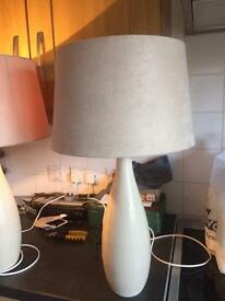Pair of tall cream lamps