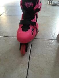 Girls pink roller skates