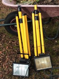 Pair of tripods with high power lamps