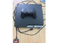 Sony PlayStation 3 Slim console and handset including 5 games