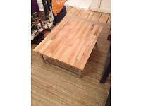 Beautiful modern coffee table, solid oak top with metal legs.