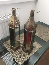 Two Moroccan standing candle lamps