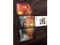 12 Insanity DVD's and elite nutrition booklet