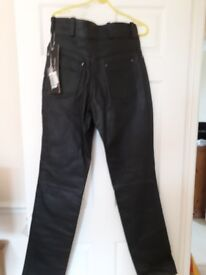 Womens black leather trousers,thick leather never been worn.still got price tag on.size medium