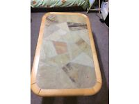 coffee table with stones design and rounded wooden edges