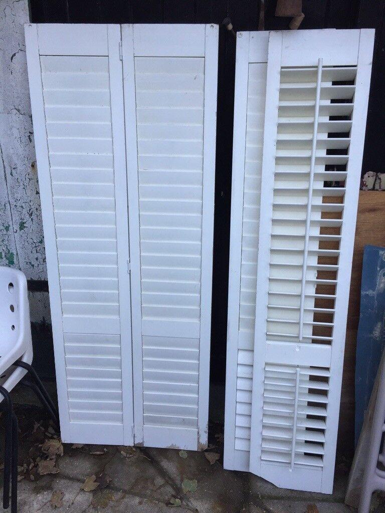 Wooden window shutters plantation style