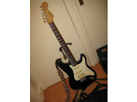 Black Stratocaster , Fender Squier amp