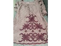 Maternity top from April Cornell. Embroided design in purple.