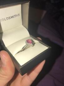 Silver ring with pink shaphire and diamonds