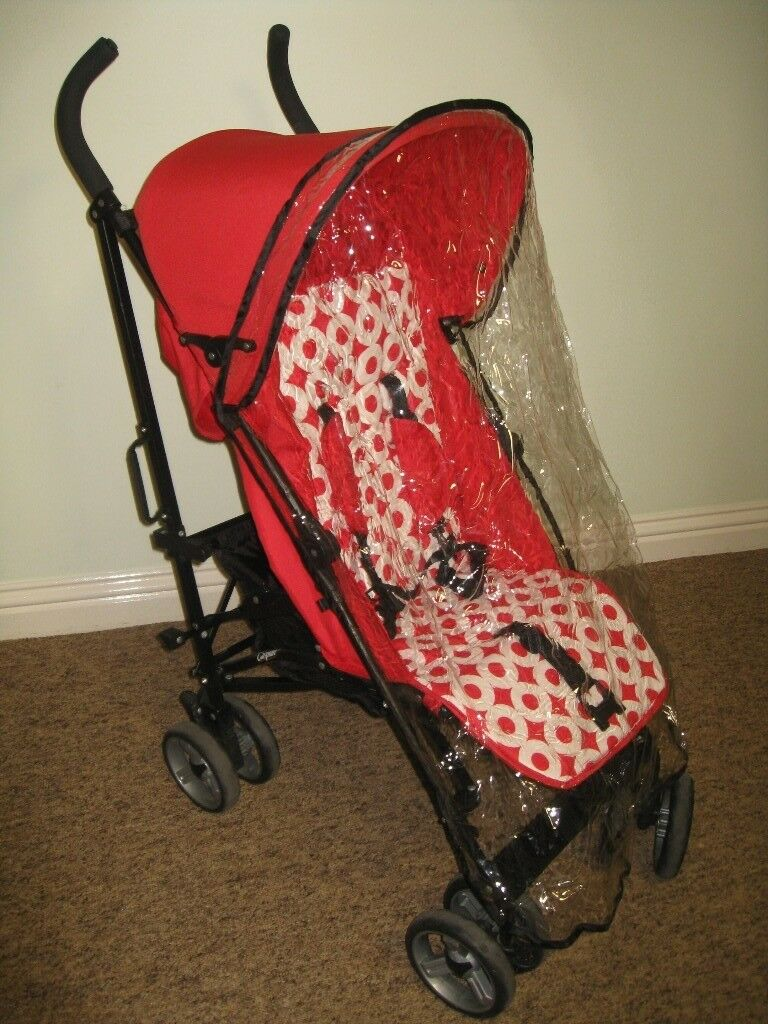Superb stroller in Red with foot-snug and waterproof cover.