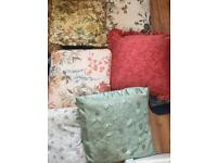 17 cushions in good condition