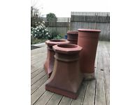 Four Chimney pots of various sizes. Would make a lovely feature in a garden or could be re-used