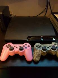 PS3 SLIM IN MINT CONDITION 2x GAMES AND 2x REMOTES