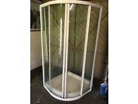 Corner shower base and sliding door enclosure