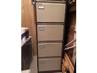 Metal four drawer filing cabinet with key