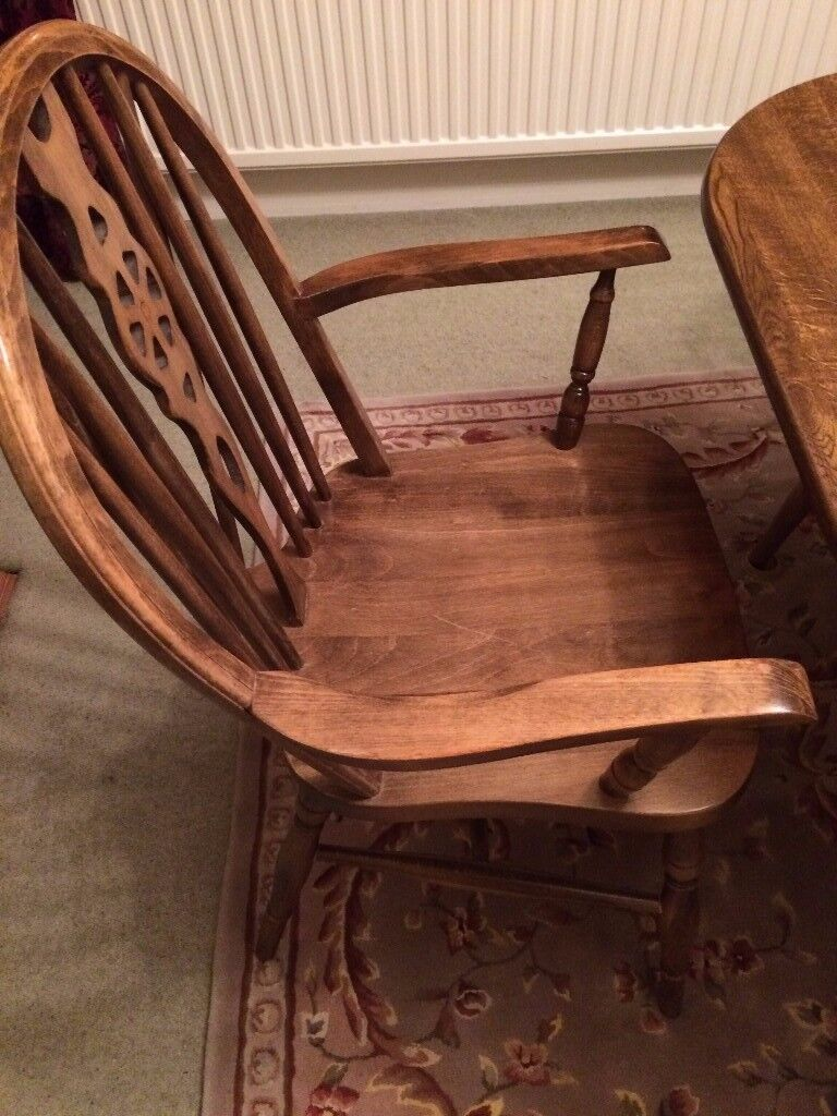 Table and 6 classic Windsor wheel back chairs, 2 of which are carvers. Can reduce table size.