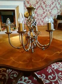 A pair of antique brass colour chandaliers