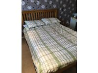 Very nice wooden bed frame and sprung mattress (if required)