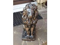 Bronze effect sitting lions