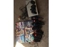 PlayStation 2 with sing star and buzz games