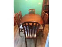 Teak extendable dining room table and 6 chairs plus matching living room unit
