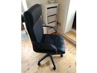 Office chair with swivel wheels. Black leather effect.