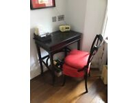 Wooden OKA desk with matching black chair; lift top.