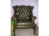 Chesterfield style green leather wingback chair and footstool