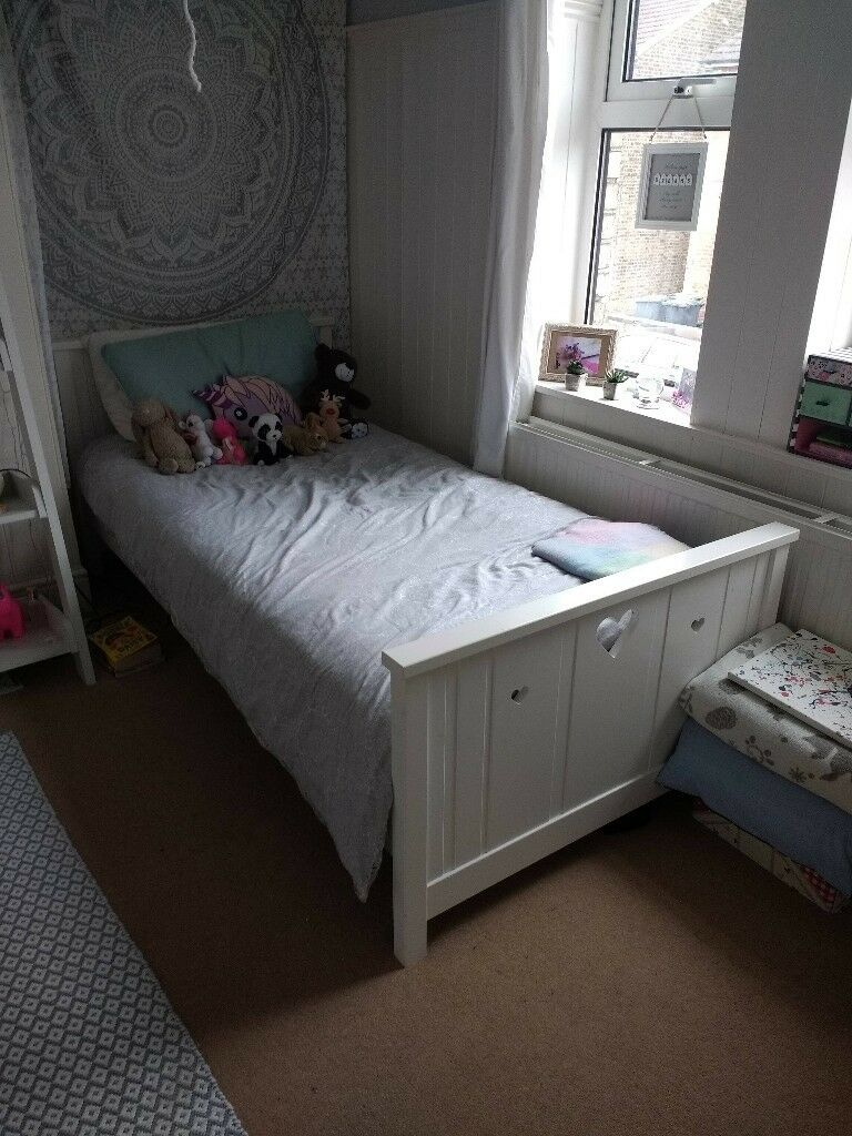 Girls wooden white single bedin Guildford, Surrey - Girls wooden white standard size single bed from John Lewis in good condition. Hearts cut out in head board and end of bed. A few small chips and marks but they could be easily touched up. Was bought for £350
