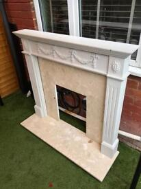 Wood fire surround with Marble Hearth and matching Marble back panel.