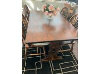 Dinning table & four chairs solid oak