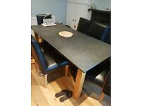 Slate dining tavle with wooden legs