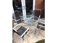 4 garden chairs and glass table