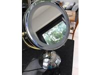 Electric make up mirror by revlon with magnifying side