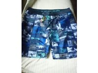 urban beach board shorts,new with tags on.