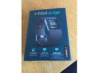 Fitbit surge, boxed