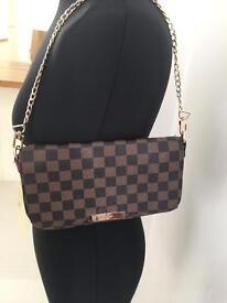 Louis Vuitton over the shoulder bag