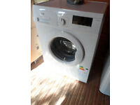 washing machine only used twice while kitchen being done still as new,1400 spin 7kg.