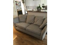Grey modern 3 seater couch with oak feet. Good condition- just needs a clean- covers washable.