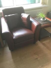 Burgundy sofa and coffee tables