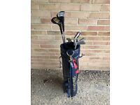 Set of 7 golf clubs irons and a leather bag