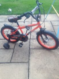 Practically brand new child's shwin bike with removable stabilisers