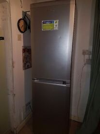 Very tall fridge freezer.