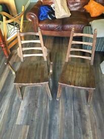 Two vintage dining chairs