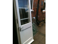 Exterior wooden door with large clear glass panel