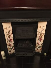 Tiled cast iron fire surround and gas fire