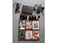 Playstation 2 slim !! gta + other games + PADS